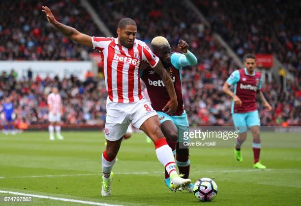 Glen Johnson of Stoke City challenges Arthur Masuaku of West Ham United during the Premier League match between Stoke City and West Ham United at...