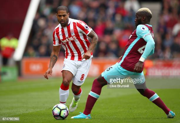 Glen Johnson of Stoke City takes on Arthur Masuaku of West Ham United during the Premier League match between Stoke City and West Ham United at...