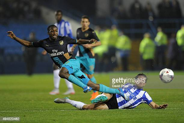 Glen Kamara of Arsenal is tackled by Sam Hutchinson of Sheffield Wednesday during the Capital One Cup 4th Round match between Sheffield Wednesday and...
