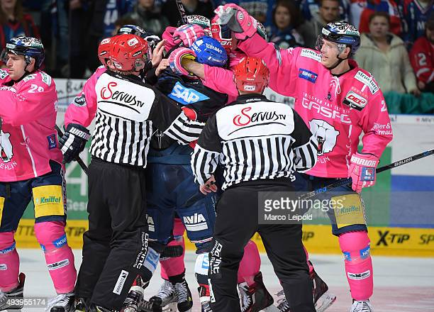 Glen Metropolit of the Adler Mannheim and Barry Tallackson of the Eisbaeren Berlin during the game between the Adler Mannheim and the Eisbaeren...