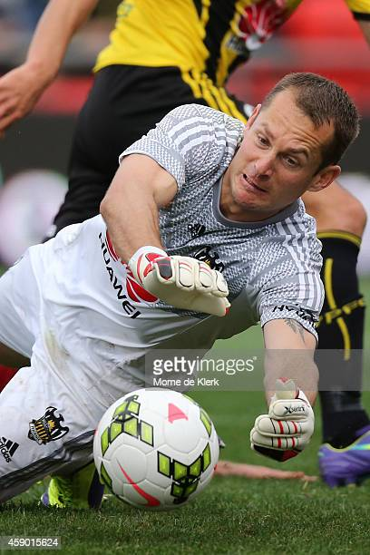 Glen Moss of Wellington Phoenix dives to make a save during the round six ALeague match between Adelaide United and the Wellington Phoenix at Coopers...