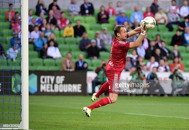 Glen Moss of Wellington Phoenix saves a shot during the round 25 ALeague match between the Melbourne Victory and the Wellington Phoenix at AAMI Park...