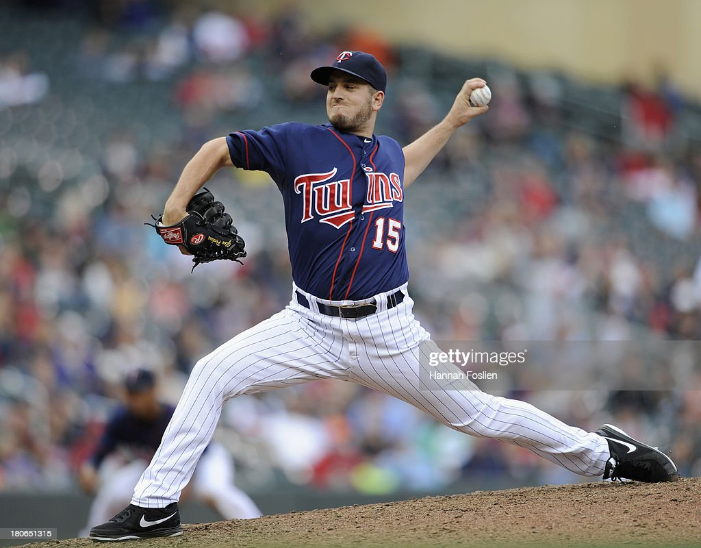 <a gi-track='captionPersonalityLinkClicked' href=/galleries/search?phrase=Glen+Perkins&family=editorial&specificpeople=835845 ng-click='$event.stopPropagation()'>Glen Perkins</a> #15 of the Minnesota Twins delivers a pitch against the Tampa Bay Rays during the ninth inning of the game on September 15, 2013 at Target Field in Minneapolis, Minnesota. The Twins defeated the Rays 6-4.