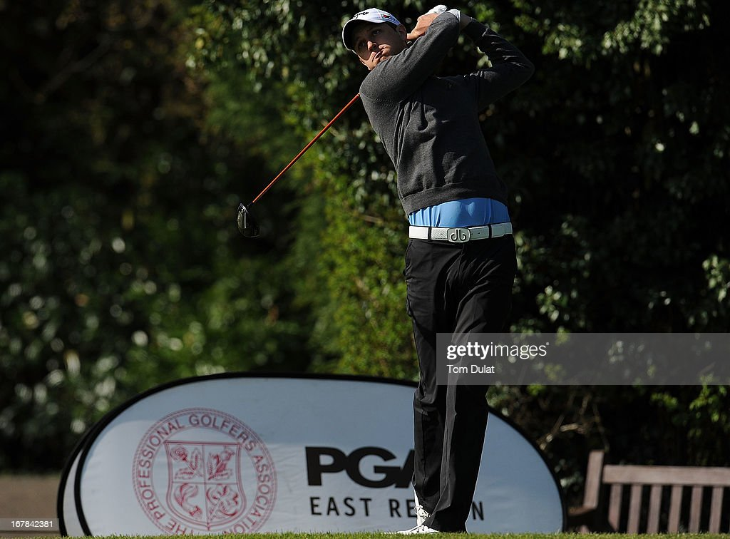 Glen Portelli tees off from the 1st hole during the Powerade PGA Assistants' Championship East Regional Qualifier at Chigwell Golf Club on May 01, 2013 in Chigwell, England.