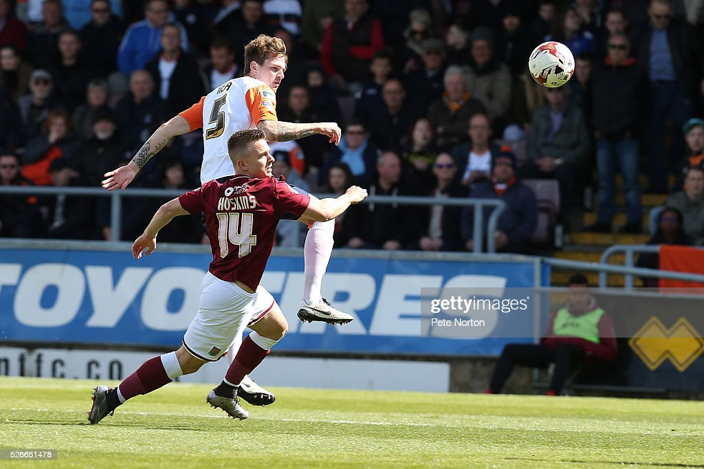Glen Rea of Luton Town contests the ball with Sam Hoskins of Northampton Town during the Sky Bet League Two match between Northampton Town and Luton Town at Sixfields Stadium on April 30, 2016 in Northampton, England.
