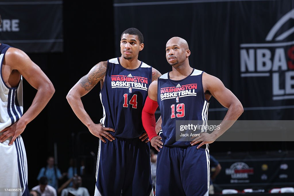 Glen Rice, Jr #14 and Sundiata Gaines #19 of the Washington Wizards look on versus the New Orleans Pelicans during NBA Summer League on July 19, 2013 at the Thomas and Mack Center Center in Las Vegas, Nevada.