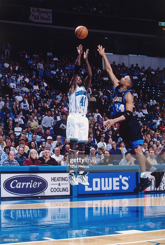 Glen Rice of the Charlotte Hornets shoots against Chris Mills of the Cleveland Cavaliers during a game circa 1997 at the Charlotte Coliseum in...