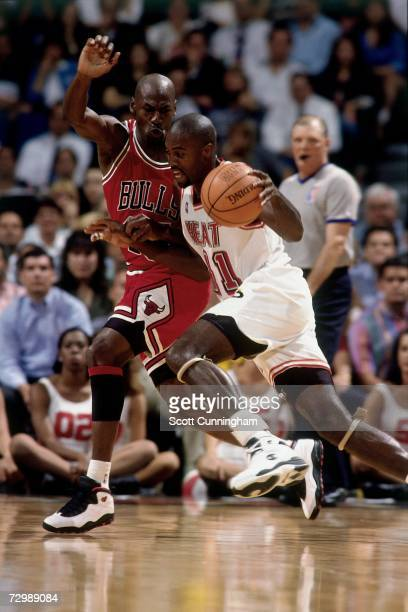 Glen Rice of the Miami Heat drives to the basket against Michael Jordan of the Chicago Bulls during a 1995 NBA game at the Miami Arena in Miami...