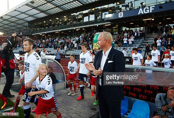 Glen Riddersholm head coach of AGF Aarhus apples his players as they walk on to the pitch prior to the Danish Alka Superliga match between AGF Aarhus...