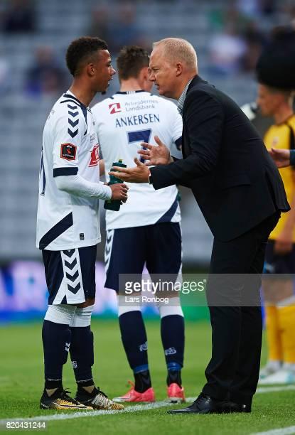 Glen Riddersholm head coach of AGF Aarhus speaks to Tobias Sana of AGF Aarhus during the Danish Alka Superliga match between AGF Aarhus and Hobro IK...