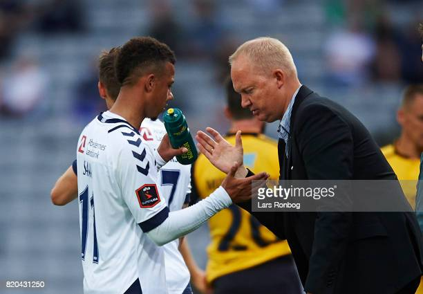 Glen Riddersholm head coach of AGF Aarhus speaks to Tobias Sana of AGF Aarhus during the Danish Alka Superliga match between AGF Aarhus and Hobro IK...