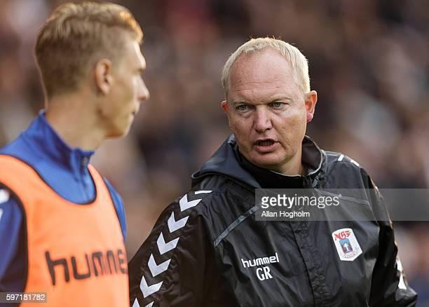 Glen Riddersholm head coach of AGF and Kasper Junker of AGF talking during the Danish Alka Superliga match between AaB Aalborg and AGF Aarhus at...