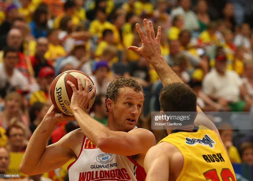 Glen Saville of the Hawks is challenged by Liam Rush of the Tigers during the round eight NBL match between the Melbourne Tigers and the Wollongong Hawks at State Netball Hockey Centre on November 25, 2012 in Melbourne, Australia.