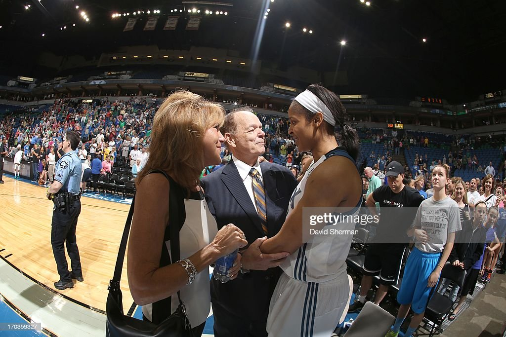 Glen Talyor, owner of of the Minnesota Lynx, and wife Becky Taylor celebrate post game with Maya Moore #23 of the Minnesota Lynx during the WNBA game on June 11, 2013 at Target Center in Minneapolis, Minnesota.