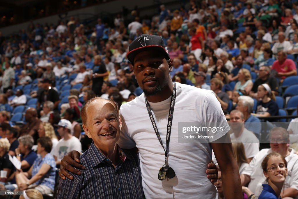 Glen Taylor, owner of the Minnesota Timberwolves poses with Oklahoma City Thunder player Kevin Durant during the Minnesota Lynx WNBA game against the New York Liberty on August 18, 2013 at Target Center in Minneapolis, Minnesota.