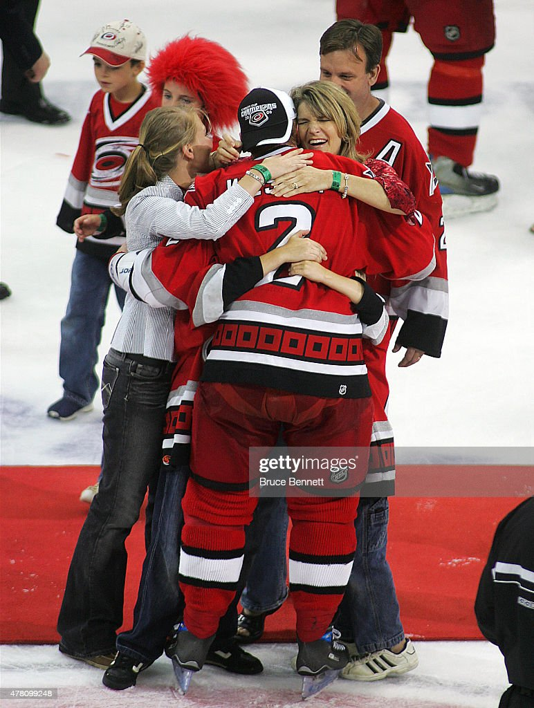 Glen Wesley #2 of the Carolina Hurricanes is greeted by his family after defeating the Edmonton Oilers to gain the NHL Stanley Cup on June 19, 2006 at the RBC Center in Raleigh, North Carolina.