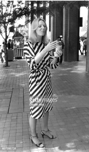 Glenda Thompson Taurus Oil Corporation employee was feeling cool while munching a hot dog wearing black and white striped dress on California Street...