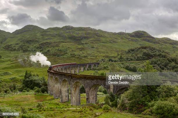 Glenfinnan viaduct with historic train passing on it