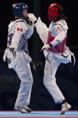 Glenhis Hernandez of Cuba competes with Jasmine Vokey of Canada during the women«s73 kg semifinal combat of WTF World Taekwondo Championships 2013 at...