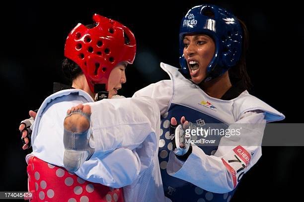 Glenhis Hernandez of Cuba connects the last point to win the gold medal of women's 73 kg final combat against InJong Lee of Korea during the WTF...