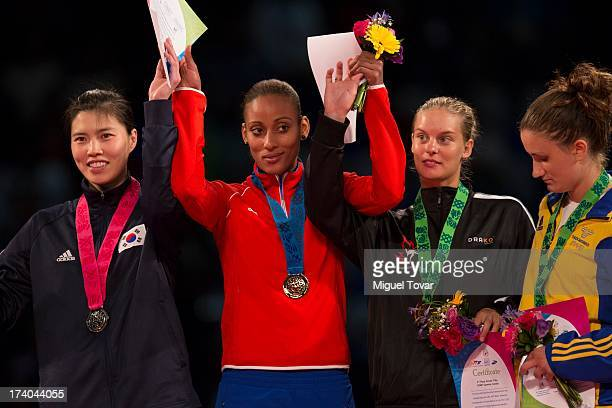 Glenhis Hernandez of Cuba receives the gold medal during the women's 73 kg final combat of WTF World Taekwondo Championships 2013 at the exhibitions...