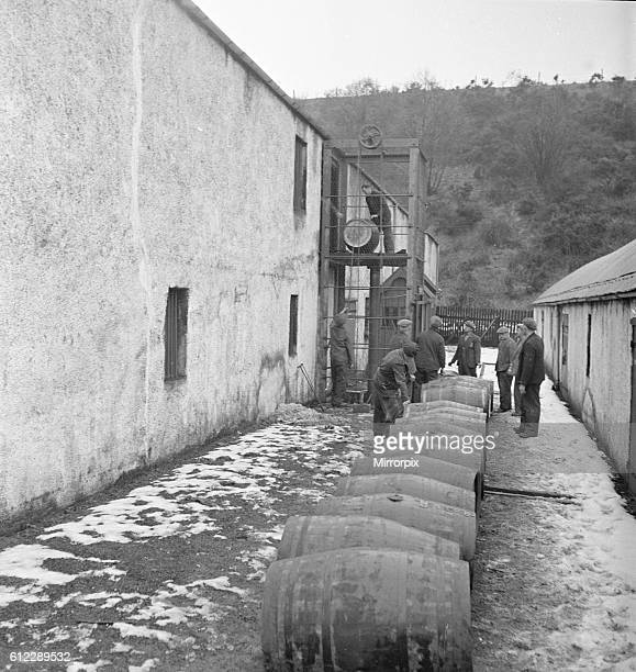 A Glenlivet Distillery workers seen here with barrels of their finest single malt whisky waiting to be placed in the bonded warehouse where it willl...