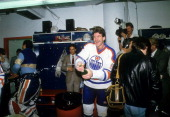 Glenn Anderson of the Edmonton Oilers celebrates with champagne in the locker room after the Oilers defeated the Philadelphia Flyers in Game 5 of the...