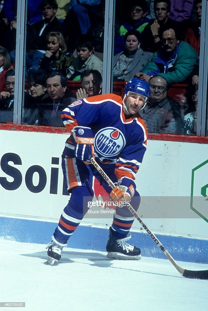 Glenn Anderson of the Edmonton Oilers looks to pass the puck during an NHL game against the Montreal Canadiens on March 17 1991 at the Montreal Forum...