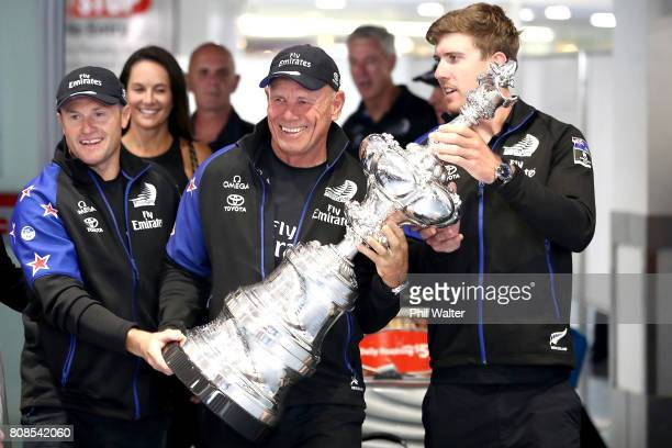 Glenn Ashby Grant Dalton and Peter Burling of Team New Zealand arrive at Auckland International Airport with the America's Cup on July 5 2017 in...