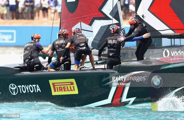 Glenn Ashby skipper of Emirates Team New Zealand congratulates helmsman Peter Burling after winning race 9 against Oracle Team USA to win the...