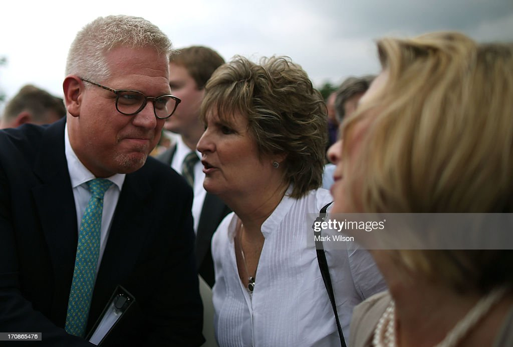 <a gi-track='captionPersonalityLinkClicked' href=/galleries/search?phrase=Glenn+Beck&family=editorial&specificpeople=3267771 ng-click='$event.stopPropagation()'>Glenn Beck</a> greets supporters after speaking at a Tea Party rally in front of the U.S. Capitol, June 17, 2013 in Washington, DC. The group Tea Party Patriots hosted the rally to protest against the Internal Revenue Service's targeting Tea Party and grassroots organizations for harassment.