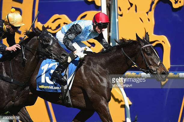 Glenn Boss riding Black Tomahawk defeats Kerrin McEvoy riding Excess Knowledge in Race 4 Harry White Classic during Melbourne Racing at Caulfield...