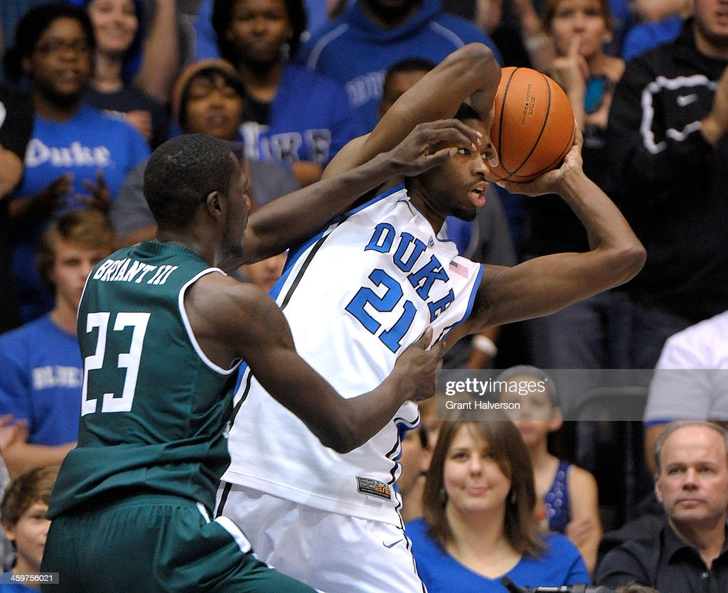 Glenn Bryant #23 of the Eastern Michigan Eagles pressures Amile Jefferson #21 of the Duke Blue Devils during their game at Cameron Indoor Stadium on December 28, 2013 in Durham, North Carolina. Duke won 82-59.