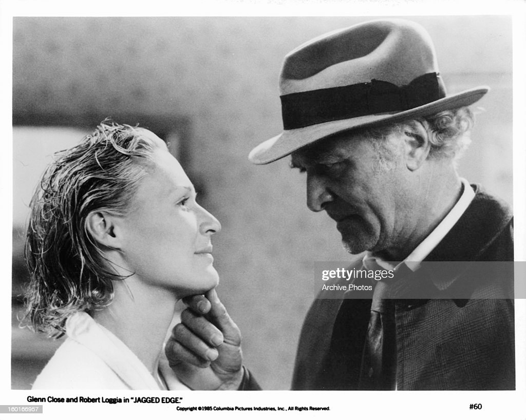Glenn Close has her chin touched by Robert Loggia in a scene from the film 'Jagged Edge' 1985