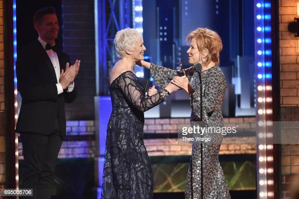 """Glenn Close presents Bette Midler with the award for Best Performance by an Actress in a Leading Role in a Musical for """"Hello Dolly"""" onstage during..."""