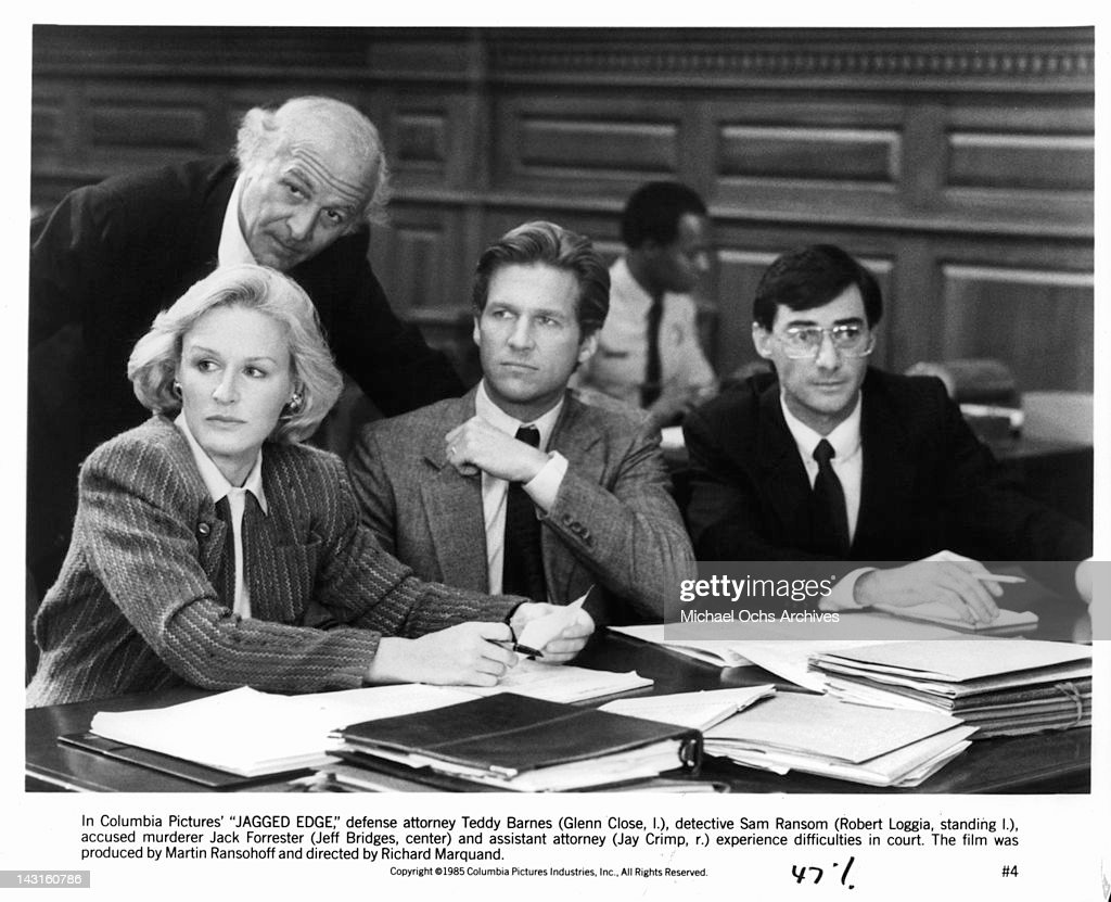 Glenn Close Robert Loggia Jeff Bridges and Jay Crimp in the court room in a scene from the film 'Jagged Edge' 1985