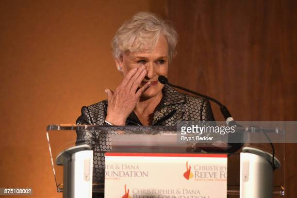 Glenn Close wipes away tears as she speaks about Christopher Reeve onstage during 'A Magical Evening' Gala hosted by The Christopher Dana Reeve...