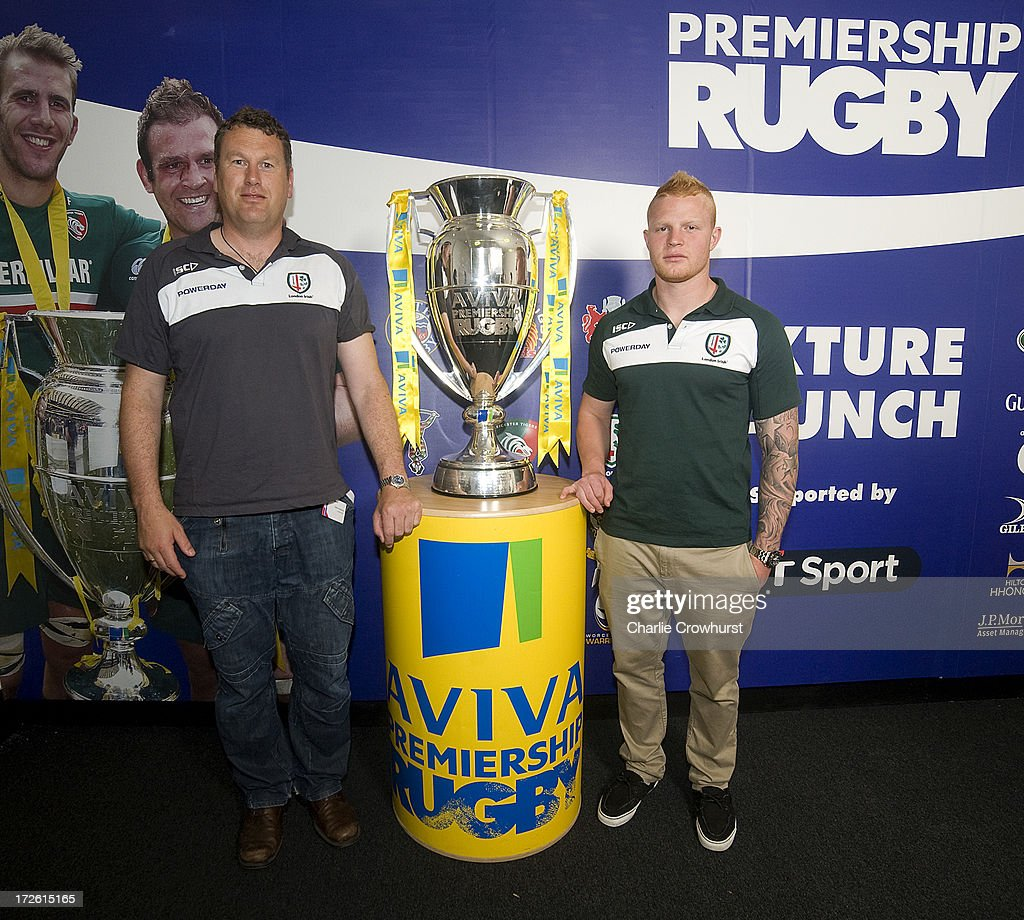 Glenn Delany and Tom Homer of London Irish stands with the Aviva Premiership Trophy during the 2013-14 Aviva Premiership Rugby Season Fixtures Announcement at The BT Tower on July 4, 2013 in London, England.