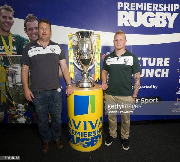 Glenn Delany and Tom Homer of London Irish stands with the Aviva Premiership Trophy during the 201314 Aviva Premiership Rugby Season Fixtures...