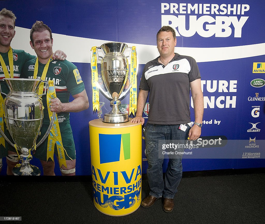 Glenn Delany of London Irish stands with the Aviva Premiership Trophy during the 2013-14 Aviva Premiership Rugby Season Fixtures Announcement at The BT Tower on July 4, 2013 in London, England.