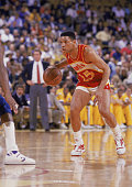 Glenn 'Doc' Rivers of the Atlanta Hawks dribbles the ball during a NBA game against the Los Angeles Lakers at the Great Western Forum in Inglewood...