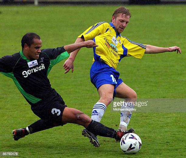 Glenn Eie from Central United is tackled by Gordon Glen Watson from Manawatu AFC in their clash in the Southern Trust National league soccer game...