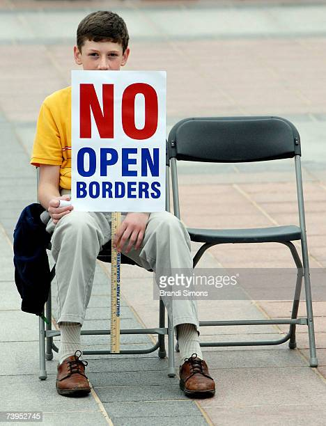 Glenn Elmore 12yearsold of Moore Oklahoma holds up a sign that reads 'NO OPEN BORDERS' during a rally sponsored by Americans for Safe Highways and...