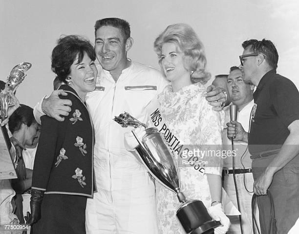 Glenn 'Fireball' Roberts driver of the Pontiac celebrates with Miss Pontiac 500 after winning the 1962 NASCAR Winston Cup Daytona 500 at the Daytona...
