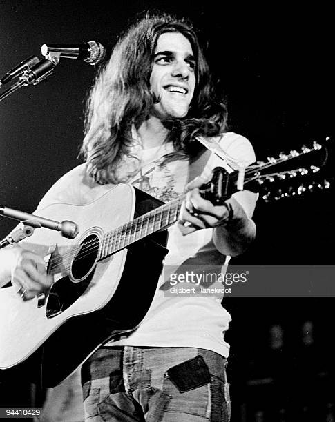 Glenn Frey of The Eagles performs on stage playing a twelve string acoustic guitar with a capo c 1974 in United States