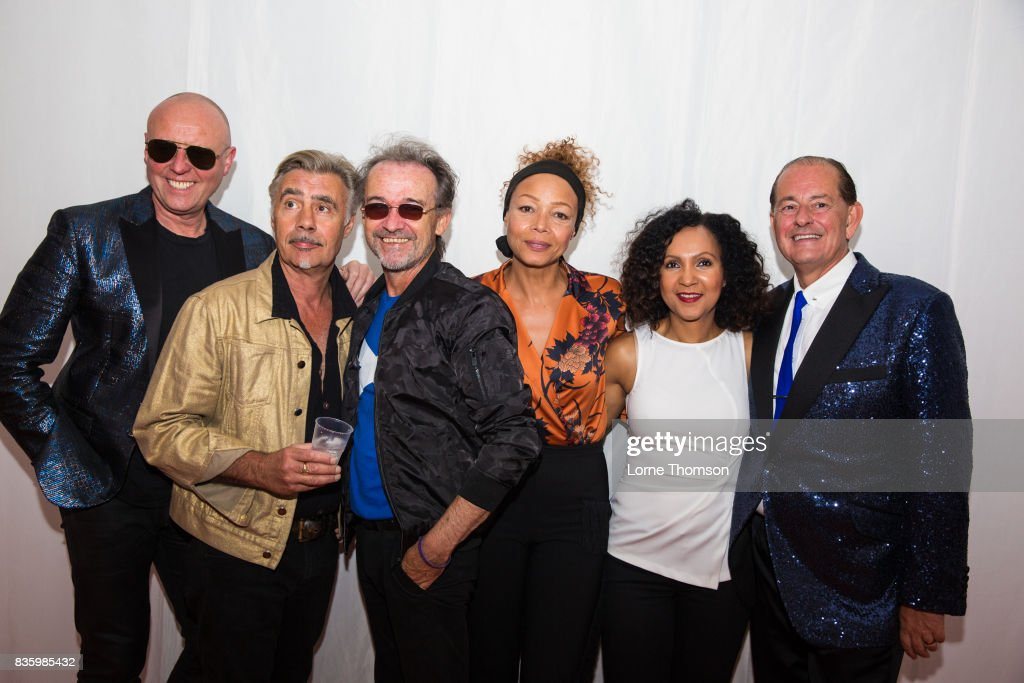 Glenn Gregory, Glenn Matlock, Owen Paul, Kim Appleby, Rozalla Miller and Martyn Ware of the British Electric Foundation pose for photographers at Rewind Festival on August 20, 2017 in Henley-on-Thames, England.