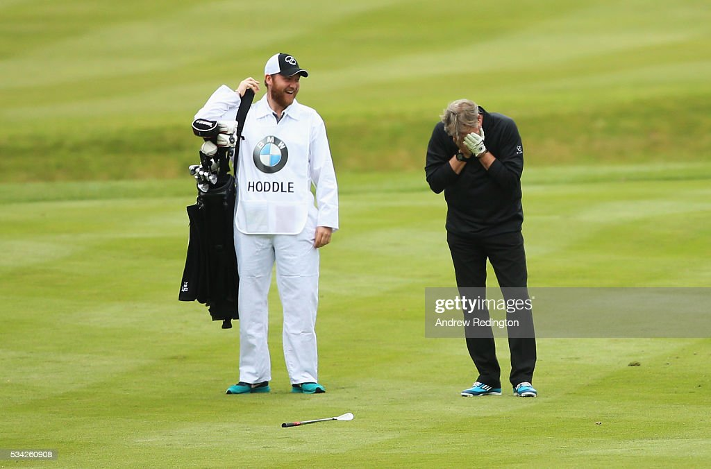 <a gi-track='captionPersonalityLinkClicked' href=/galleries/search?phrase=Glenn+Hoddle&family=editorial&specificpeople=217513 ng-click='$event.stopPropagation()'>Glenn Hoddle</a> reacts on the 18th hole during the Pro-Am prior to the BMW PGA Championship at Wentworth on May 25, 2016 in Virginia Water, England.
