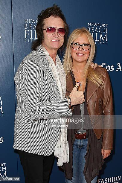 Glenn Hughes and Regina Russell attend the 2014 Newport Beach Film Festival World Premiere of yhe Quiet Riot documentary 'Well Now You're Here...