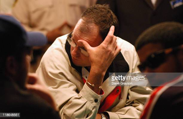 Glenn Hughes looks on as an opponent shows a winning hand during day six of the 2004 World Series of Poker at Binion's Horseshoe Club and Casino in...