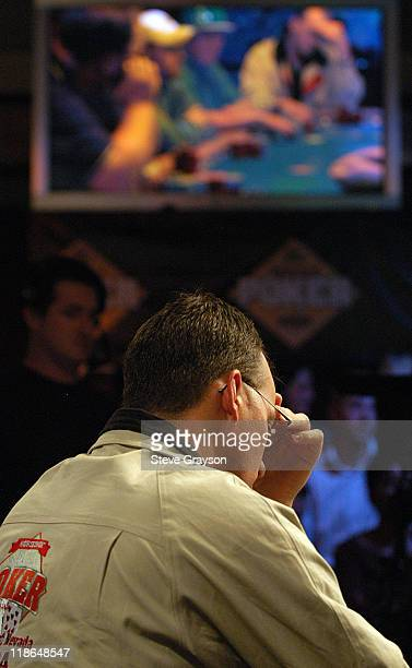 Glenn Hughes looks over the table in the final round of the 2004 World Series of Poker at Binion's Horseshoe Club and Casino in Las Vegas Nevada May...